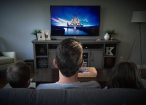 dad watching disney with kids