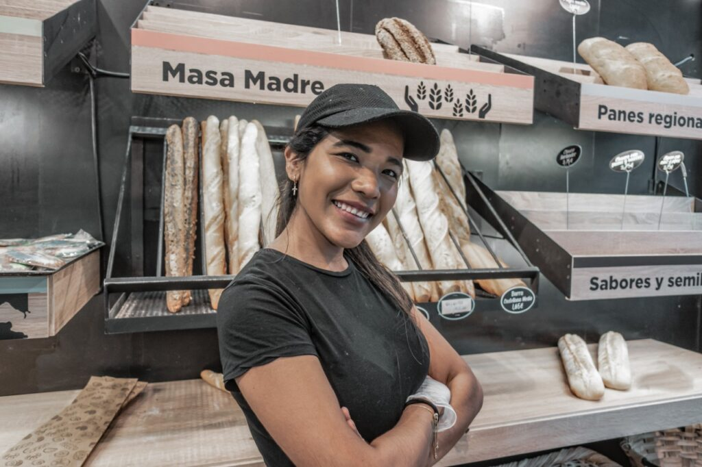 Latin Business Owner showing off her business